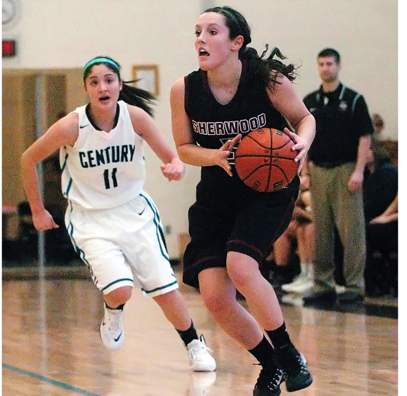 by: DAN BROOD - ON THE GO -- Sherwood High School sophomore point guard Taylor Corno, in front of Century sophomore Chantal Castaneda, looks to get the ball up court during last Thursday's game.