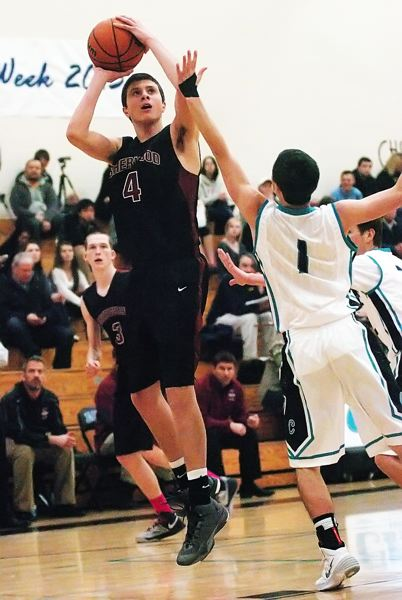 by: DAN BROOD - TAKING AIM -- Sherwood junior Tommy Paul (left) shoots over Century's Bryce Bangerter.