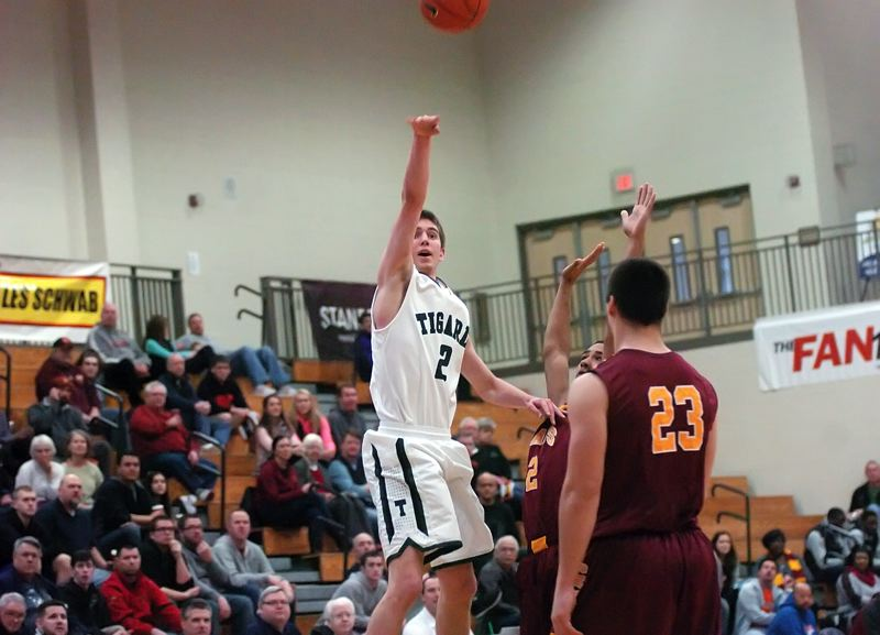 by: DAN BROOD - LET IT FLY -- Tigard senior Nick Kaelin takes a long-range shot during the second half of Friday's game at the Les Schwab Invitational.