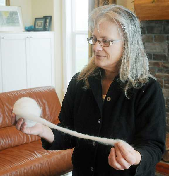 by: SETH GORDON - Spun -- Anne Brown sells raw wool that has become popular with local spinners.