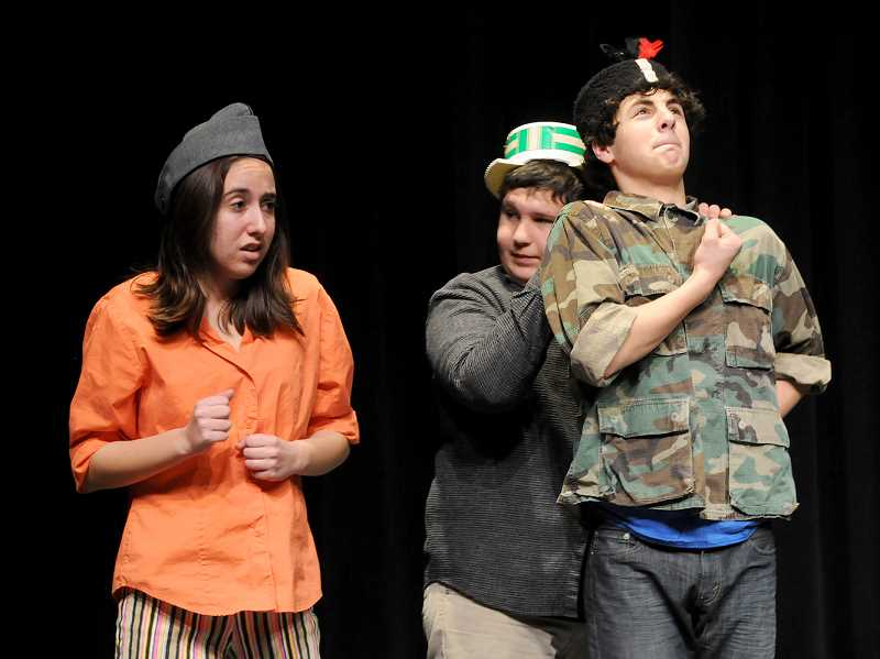 by: SETH GORDON - Competing for laughs -- Newberg High School sophomores (from left to right) Claire Retter, Cameron Lammers and Alex Foufos rehearse a scene from 'In a Strange Land,' a comedy that the sophomore class will  perform this weekend as part of the NHS tournament of plays.
