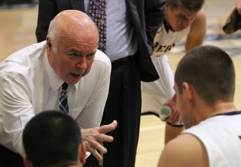 by: COURTESY OF KLAMATH FALLS HERALD AND NEWS - Danny Miles, coach of the Oregon Institute of Technology Owls, gives instructions during a timeout. He needs two more wins to reach 1,000 for his career.