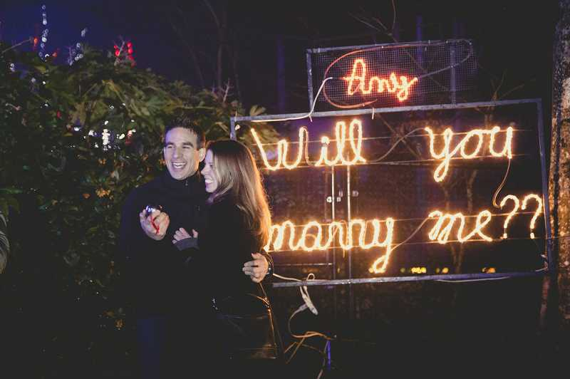 by: SUBMITTED PHOTO: KAT DOSSETT - Brian Engelhard knew he wanted to do something special for his proposal to Amy Miller, so he staged a flash mob at ZooLights in Portland.