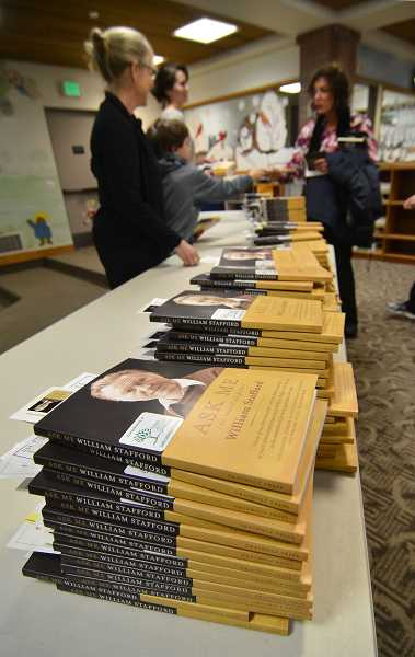 by: VERN UYETAKE - Nearly 1,000 copies of William Stafford's 'Ask Me' were distributed Tuesday evening at the Lake Oswego Reads kickoff event.