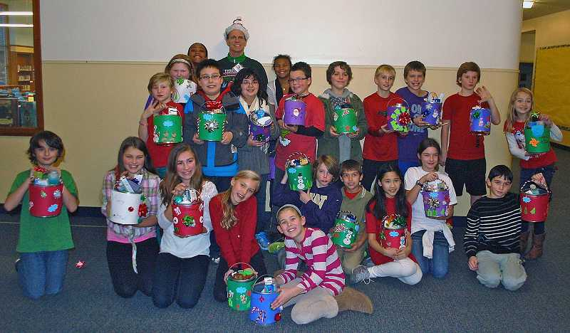 by: SUBMITTED PHOTO - Teacher Ron Bagwells fifth-grade class was one of three at Forest Hills that supported a nonprofit group, Central City Concern.