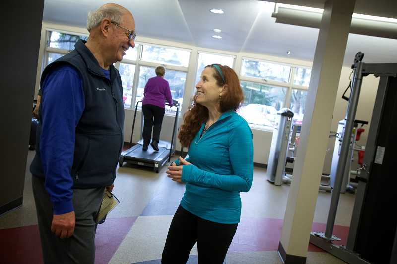 by: TIMES PHOTO: JONATHAN HOUSE - Diane Brice, newly retired fitness director at the Elsie Stuhr Center, chats with Elsie Stuhr Center regular Wolfgang Dempke.