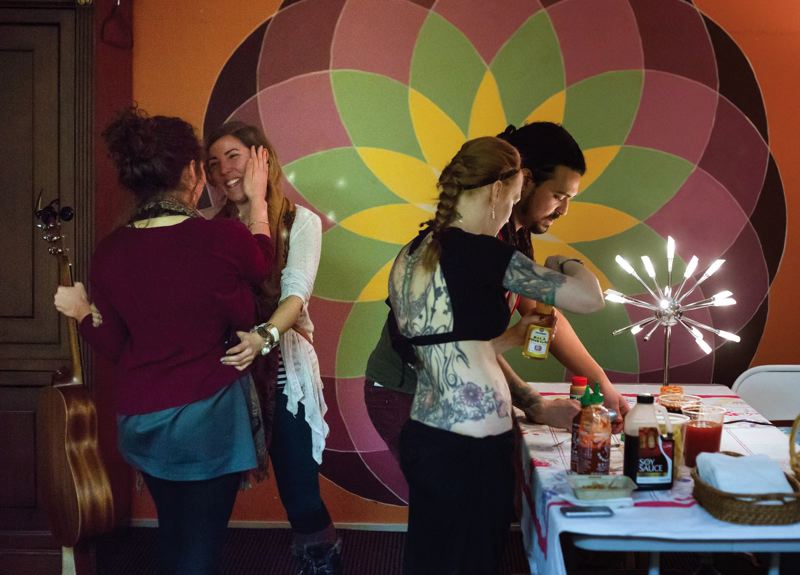 by: TRIBUNE PHOTO: JONATHAN HOUSE - Portland 4 the Philippines organizers saw a good turnout for their art auction and musical performances at last Saturdays fundraiser.