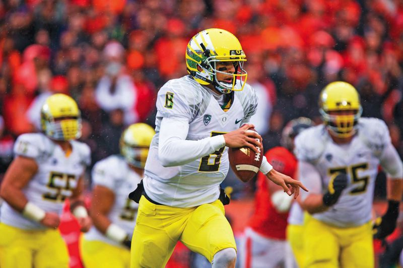 by: TRIBUNE FILE PHOTO: CHRISTOPHER ONSTOTT - Quarterback Marcus Mariota says that while the Oregon Ducks improved their field-goal kicking in 2013, they need to score more touchdowns in 2014.