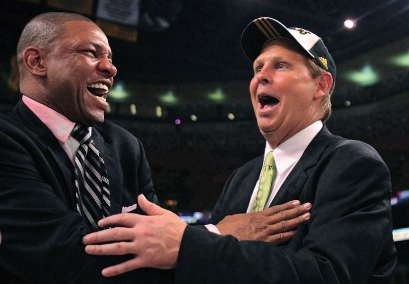by: COURTESY PHOTO - Oregonian Danny Ainge celebrated the Boston Celtics NBA championship with then-coach Doc Rivers. Ainge has been instrumental in rebuidling the Celtics.