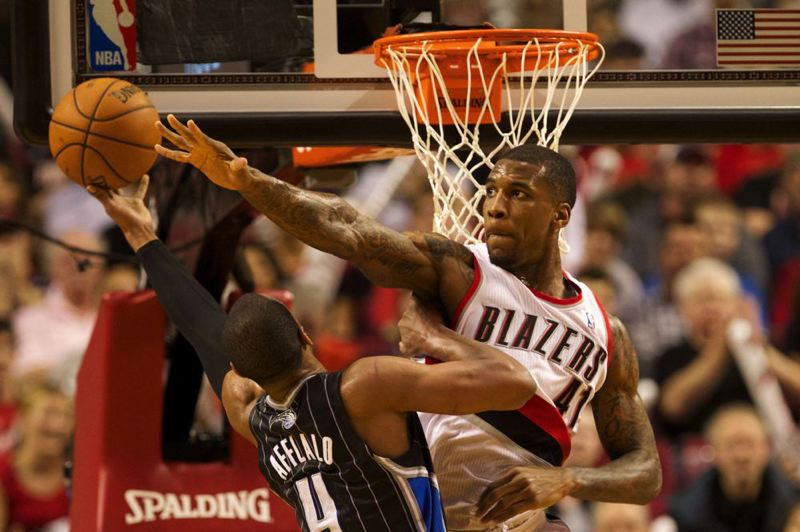 Helping to ignite the Trail Blazers' second-half rally, reserve forward Thomas Robinson blocks a shot by Orlando guard Arron Afflalo.