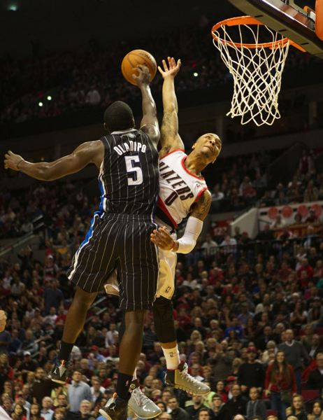 Orlando guard Victor Oladipo denies Damian Lillard on the Blazer guard's dunk attempt in the second half.