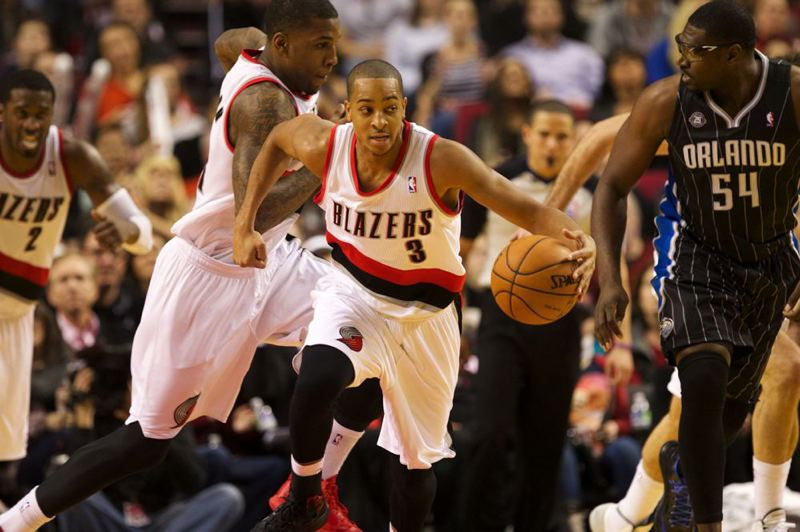 In his NBA debut, rookie guard CJ McCollum of Portland starts a fast-break attempt.