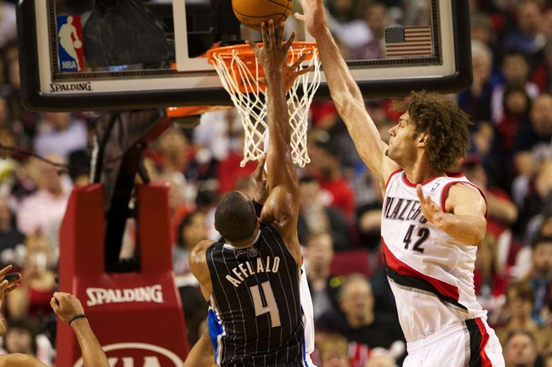 Portland center Robin Lopez (right) gets a piece of Arron Afflalo's shot during the second half.