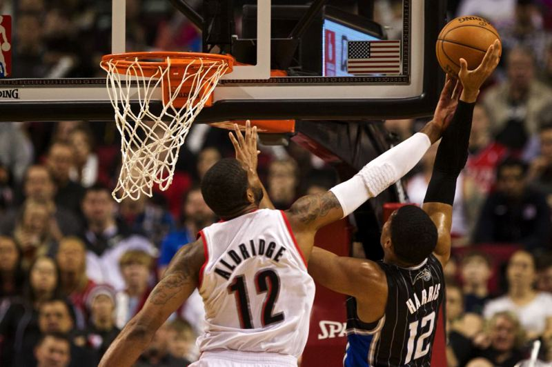 LaMarcus Aldridge redirects Tobias Harris' shot.