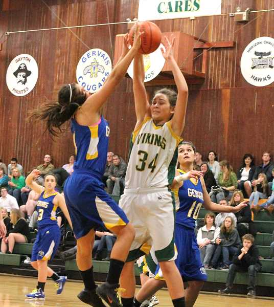 by: CORY MIMMS - Viking Tavia Boll goes head to head with Gervais's Andrea Villegas.
