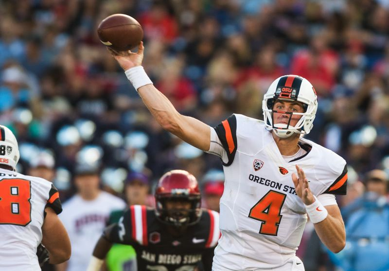 by: COURTESY OF KARL MAASDAM - Oregon State coach Mike Riley relayed to Sean Mannion what NFL scouts were saying about the Beavers quarterback, who then decided to stay at OSU for his senior season.