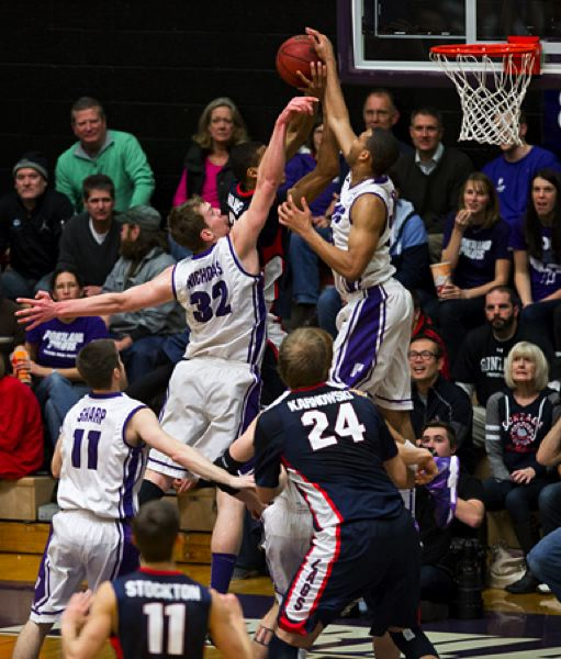 by: COURTESY OF STEVE GIBBONS - Portland's Kevin Bailey, with help from teammate Ryan Nicholas, blocks an inside shot by Gonzaga.