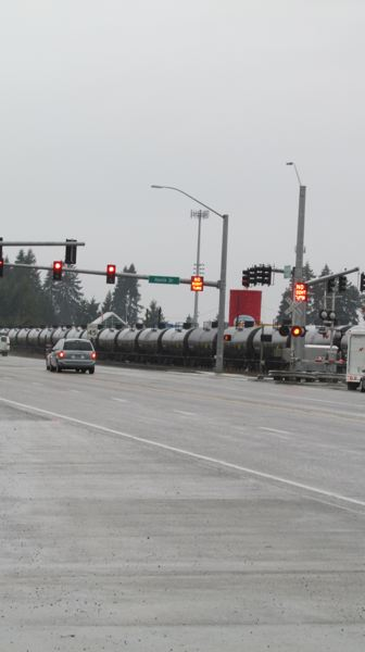 by: SPOTLIGHT PHOTO: MARK MILLER - A unit train of tank cars travels through Scappoose on Thursday, Jan. 9, on the Portland and Western Railroad.