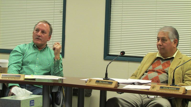by: SPOTLIGHT PHOTO: MARK MILLER - St. Helens School District board member Jeff Howell, left, and Superintendent Mark Davalos, right, at the school board work session Wednesday, Jan. 8.