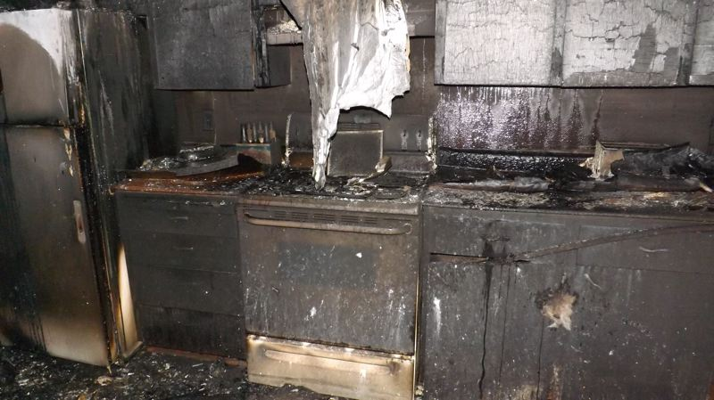 by: FOREST GROVE FIRE AND RESCUE - Contents of the house were deemed a total loss following an explosion in the kitchen.