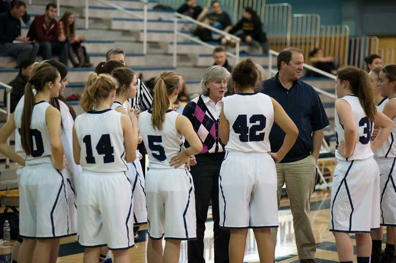 by: GREG ARTMAN - Wilsonville girls basketball coach Cindy Anderson (center) is hoping for better shooting efficiency and improved execution on defense as her team enters its league slate.