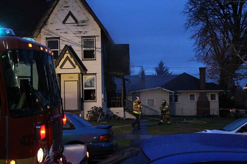 by: NEWS-TIMES PHOTO: JOHN SCHRAG - Forest Grove firefighters returned to the scene of the early morning blaze at about 7:30 a.m. after the fire flared up again.