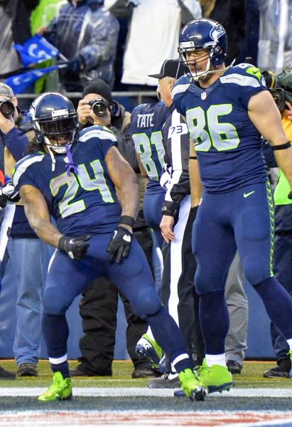 by: COURTESY OF MICHAEL WORKMAN - Marshawn Lynch (left) celebrates one of his two rushing touchdowns with Seattle Seahawks teammate Zach Miller.