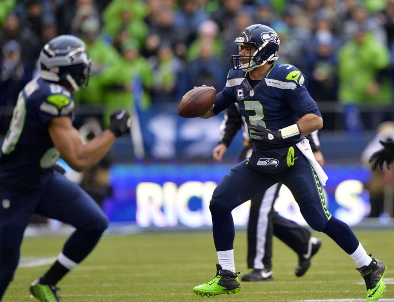 Seattle quarterback Russell Wilson prepares to make a pitch.