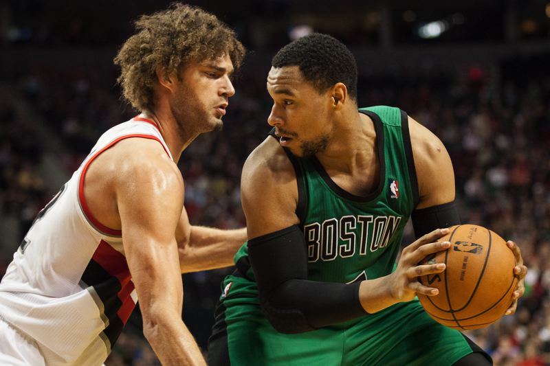 Blazers center Robin Lopez (left) plays one-on-one defense against Jared Sullinger of the Celtics.