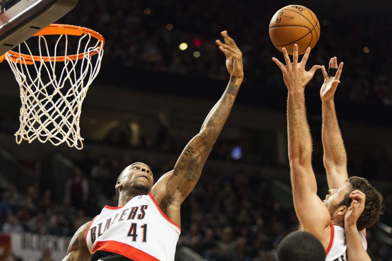 Thomas Robinson (left) and Joel Freeland go for a Portland rebound.