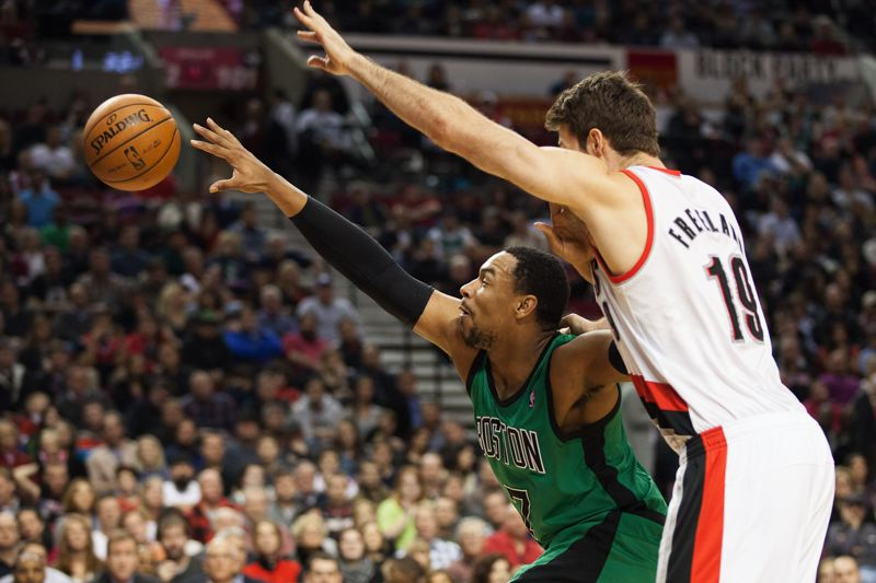 Joel Freeland defends in the post against Boston's Jared Sullinger.
