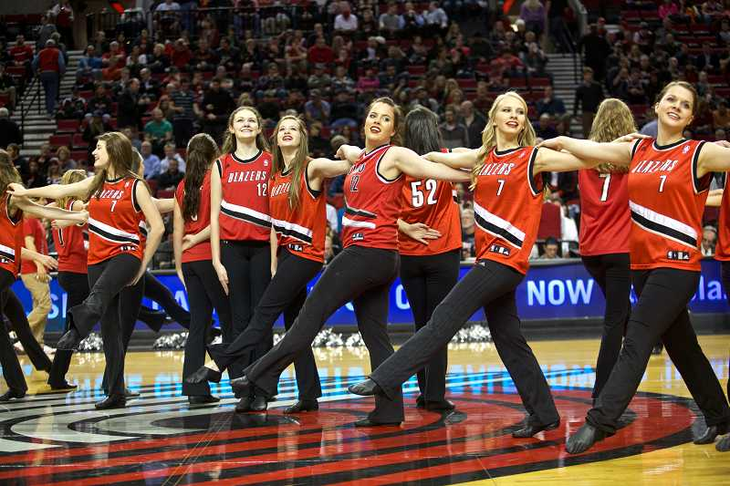 by: JAIME VALDEZ / PAMPLIN MEDIA GROUP - Members of the Canby dance team link arms during their routine Jan. 8 at the Moda Center.