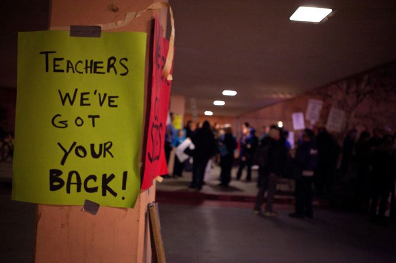by: TRIBUNE PHOTO: ADAM WICKHAM - A sign taped at a rally Monday evening shows student support for Portland Public School teachers during a noisy gathering outside the Blanchard Education Student Center in North Portland.