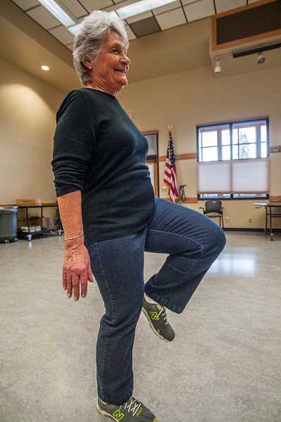 by: JOSH KULLA - Delores Mouck takes part in the Wilsonville Community Centers senior fitness testing program Friday morning. This exercise requires the individual to take exaggerated high steps for two minutes to test the cardiovascular system.