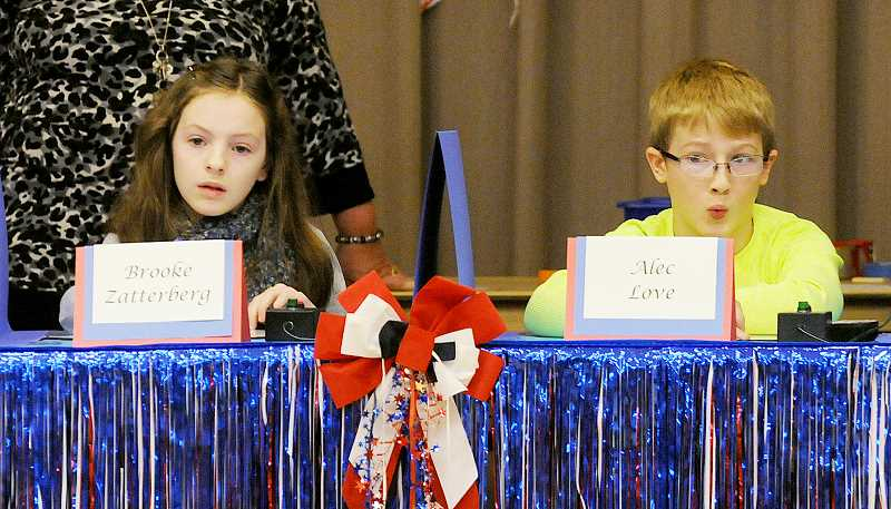 by: GARY ALLEN - Tough question -- Brooke Zatterberg and Alec Love react to a question during Friday's National Geographic Bee at Dundee Elementary.