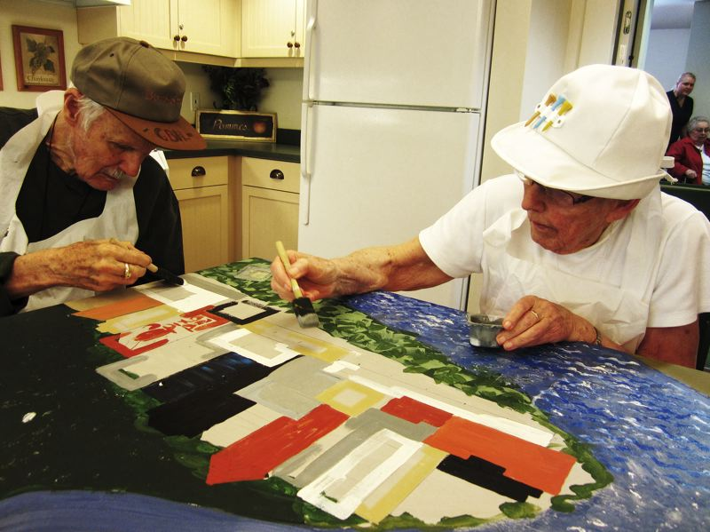 by: SUBMITTED PHOTO - Two Springridge Court residents work on a large mural that now graces the dining room at the Charbonneau assisted living facility.