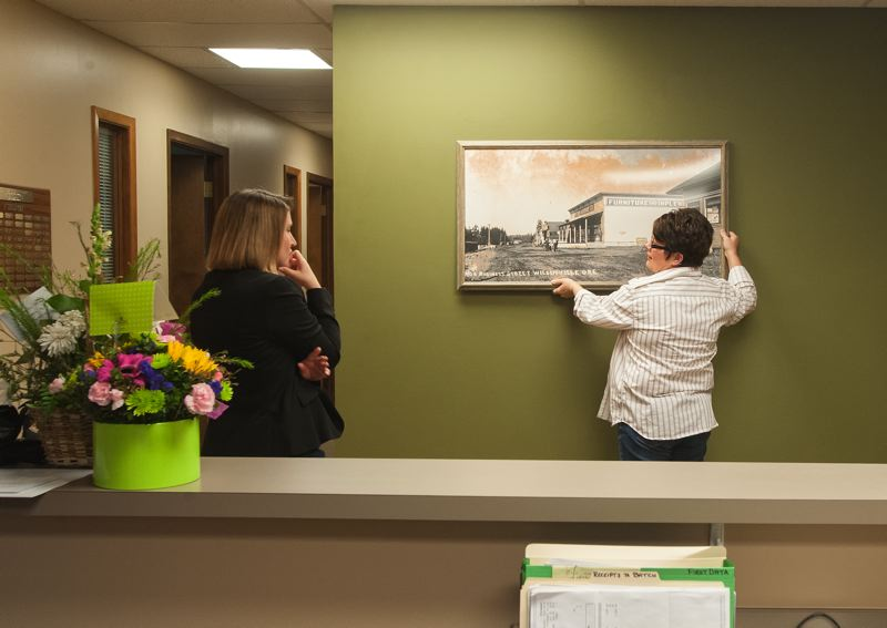by: SPOKESMAN PHOTO: JOSH KULLA - Wilsonville Chamber of Commerce Communications Director Krissy Rowan (left) and staff member Tammy Beal proceed with redecorating the organizations new office space on Salish Lane in north Wilsonville. The offices opened to the public Jan. 6.