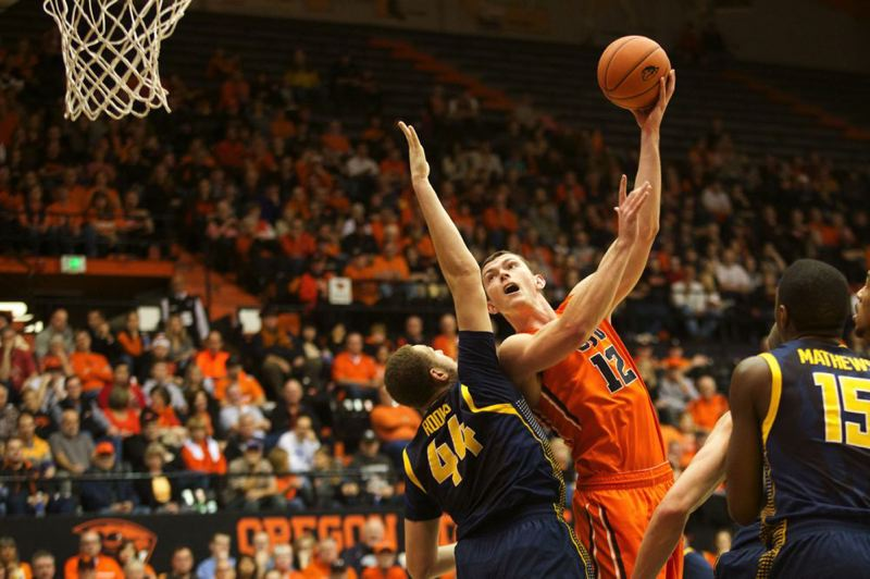 by: TRIBUNE PHOTO: JAIME VALDEZ - Oregon State center Angus Brandt shoots over Cal center Kameron Rooks in a game last week at Gill Coliseum. On Sunday night, the Beavers play host to Oregon in round one of the 2013-14 season Civil War series.