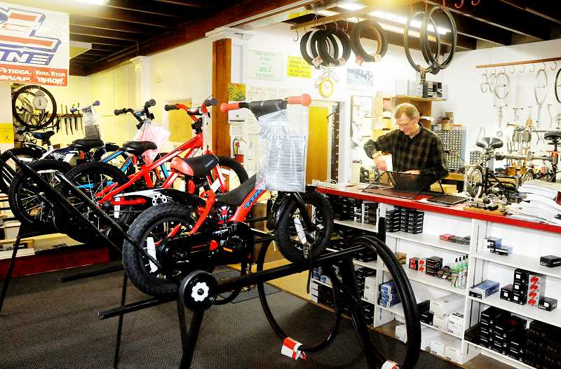 by: GARY ALLEN - End of an era -- After 22 years in business, Newberg Bike Shop owner David Herr and his wife Cheri are closing the shop's doors in order to spend more time with family.