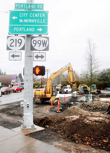 by: GARY ALLEN - Under construction -- A new branch of the Human Bean drive-thru espresso chain will open in the spring. Construction has begun in the Key Bank parking lot on Portland and Villa roads.