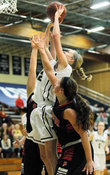 by: SETH GORDON - Put back- Lauren Codling rises for two of her nine points during George Fox's 78-48 victory over Pacific Saturday night at Miller Gym. The No. 8 Bruins are 13-0 overall and 4-0 in the Northwest Conference.