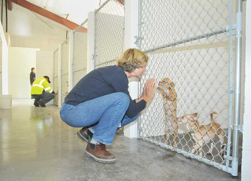 by: GARY ALLEN - A long time coming - During the summer the new animal shelter building was completed and volunteers began moving in dogs and cats to the Sandoz Road facility.