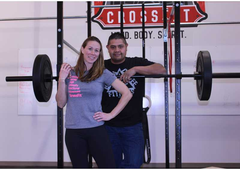 by: SUSAN MATHENY/MADRAS PIONEER - Melissa and Claude Smith are eager to bring CrossFit training to the Madras area.