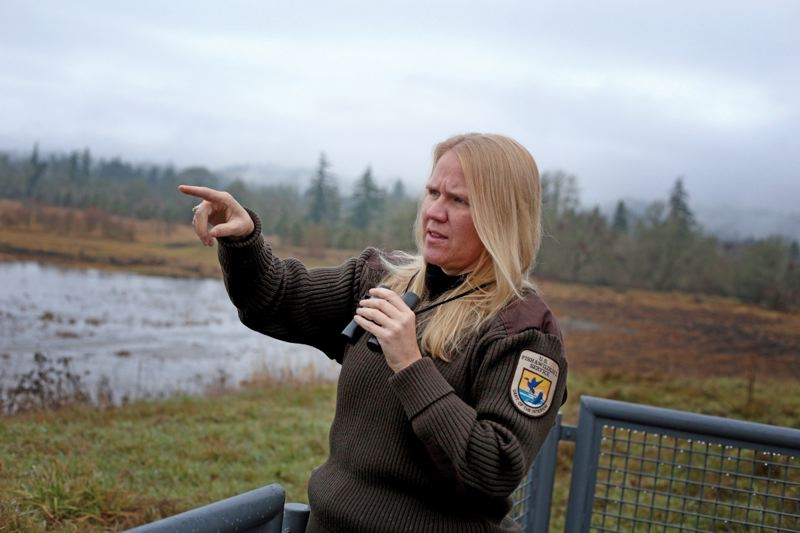 by: PAMPLIN MEDIA GROUP: JONATHAN HOUSE - Tualatin River National Wildlife Refuge visitor services manager Kim Strassberg points out different bird species at the viewing deck.