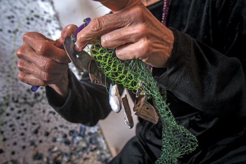 by: PAMPLIN MEDIA GROUP: JONATHAN HOUSE - Bonnie Meltzer knits a fishing line and shells