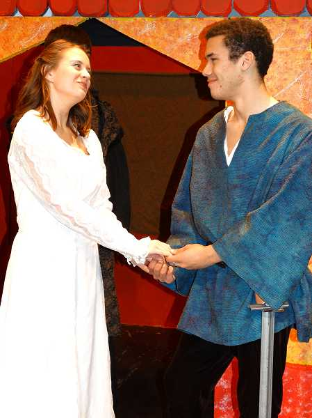 by: COURTESY PHOTO: DONNA BENEFIEL - Megan Brown playing Hero and Nick Neider playing  Claudio take over the stage as young lovers in Shakespeares Much Ado About Nothing.