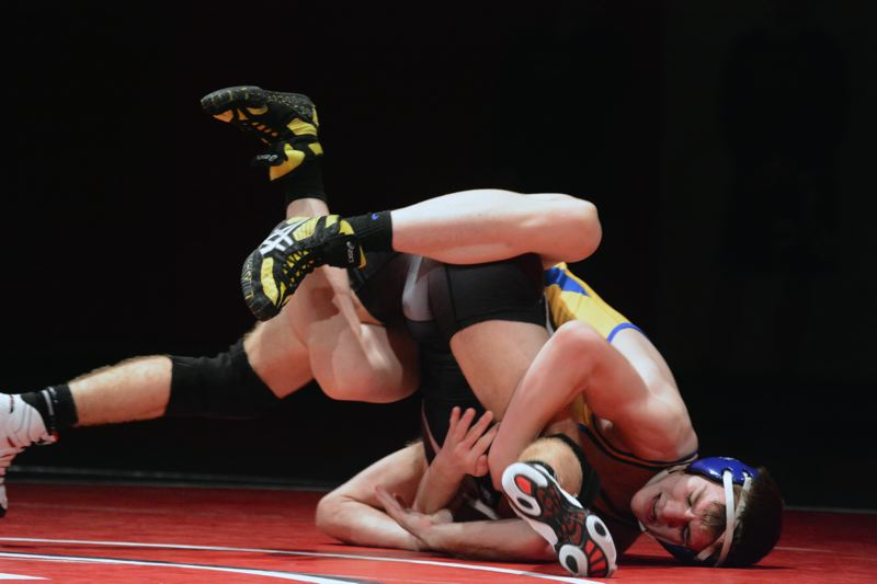 by: TIMES PHOTO: MATT SINGLEDECKER - Aloha 138-pound wrestler Cason Wight won his match in six minutes against Westview last Wednesday.