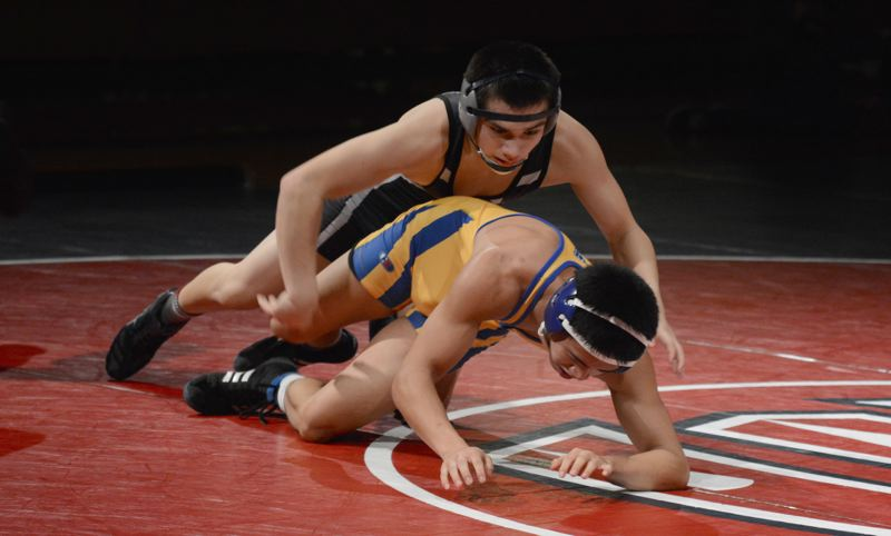 by: TIMES PHOTO: MATT SINGLEDECKER - Westview 132-pound wrestler David Escobar was the fifth straight Wildcat to beat Aloha on Wednesday.