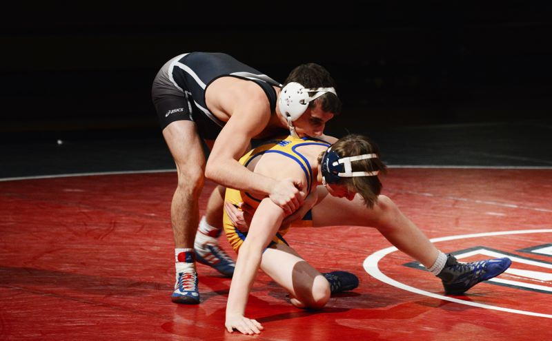 by: TIMES PHOTO: MATT SINGLEDECKER - Westview senior captain Joel Timmons won his match against Aloha to help the Wildcats build a big lead early on against the Warriors.