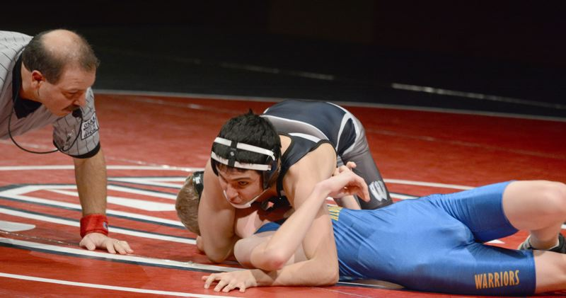 by: TIMES PHOTO: MATT SINGLEDECKER - Westview 113-pound Juan Garcia-Hernandez notched the Wildcats fastest pin of the night, flattening his Aloha opponent in 16 seconds.